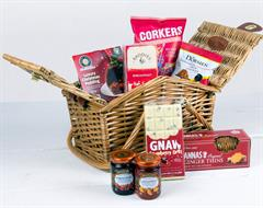 Small willow basket with split lid and drop down handles, This Red hamper include tea, biscuits, christmas pudding, preserves, chocolate, crisps and nuts