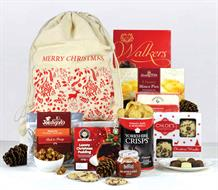 Santa sack with a christmas design printed on it filled with christmas food favourites