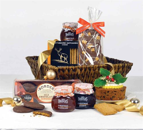 this scottish rattan basket comes with a range of scottish luxry products including award winning arran cheese, luxury christams cake, preserves and chutneys, tea, biscuits, fudge adn a selection of the christmas items