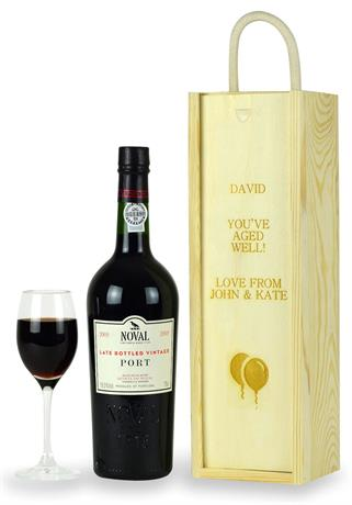a bottle of lbv port with an engraved wooden box